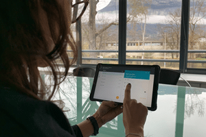 patient at home with a tablet